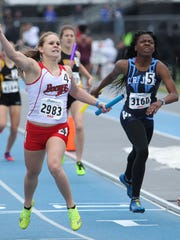 Sophomore Dianna Slight celebrates after carrying the Boone girls' 800 sprint medley relay team to the title at the Drake Relays on Friday, April 24, 2015.