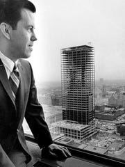 Richard Lugar poses in 1968 for a photograph in his City/County building office, overlooking construction of the Indiana National Bank building at Pennsylvania and Ohio streets.