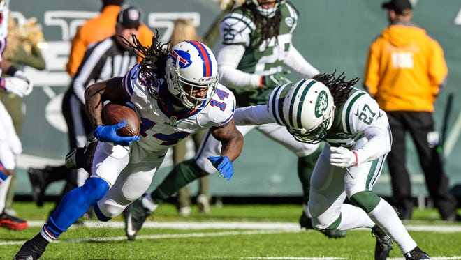 Jan 1, 2017; East Rutherford, NJ, USA;  New York Jets cornerback Darryl Roberts (27) tackles Buffalo Bills wide receiver Sammy Watkins (14) after a reception in the 1st quarter at MetLife Stadium.