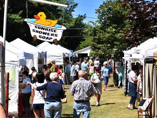 Visitors flock to the tents and displays last year