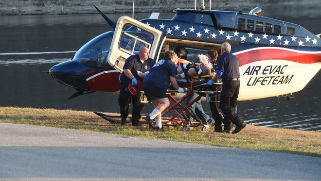 Emergency personnel load 71-year-old Perry Kincade into an Air Evac helicopter Thursday following a boating accident. Kincade, of Jonesboro, passed away Tuesday as a result of injuries he suffered in the accident.