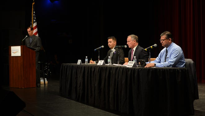 David Maron, from left, moderates a panel of Oxnard mayoral candidates last month, including Miguel Lopez, incumbent Tim Flynn and Armando Sepulveda at the Oxnard Performing Arts and Convention Center.