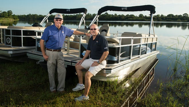 Ralph Poppell (left), CEO of Island Boats, and his son Tim Poppell, president of Island Boats, in Vero Beach. The two are responsible for a revolutionary new design for pontoon boats that make them easier to transport while not sacrificing performance.