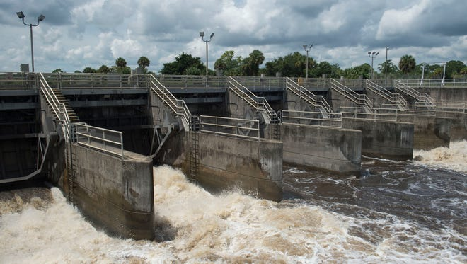 Water from Lake Okeechobee is discharged through the St. Lucie Lock and Dam on Wednesday, Sept. 6, 2017 in Stuart.
