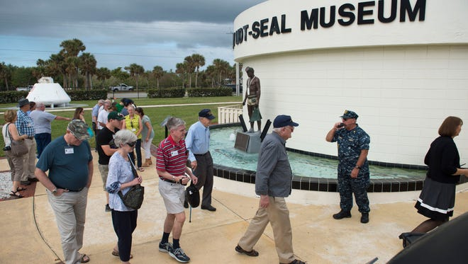 """World War II Navy Frogmen/UDT veterans Harold Hall, Arne Kvaalen, Fred Ferber, Spike Field and Doug Ray attended the opening of the renovated World War II Gallery on Friday, Nov. 3, 2017 at the the National Navy UDT-SEAL Museum on North Hutchinson Island near Fort Pierce. """"I'm very humbled by what I see here,"""" Hall said of the gallery. """"It's a great legacy."""""""