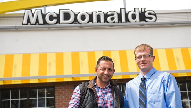 Grant Skyllas (left) and his father Georgios (not pictured) have purchased three McDonald's in York County. Kyle O'Neil (right) is the group's operations manager.