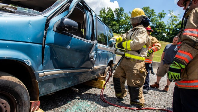 Emi Nwabueze, of Columbia, Maryland, uses a tool to open a door on a minivan during training on Wednesday. First-year residents at WellSpan York Hospital learned how first responders operate and rescue victims from vehicles, during the annual 'EMS Skills Day' at the York County Fire School.