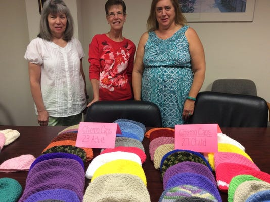 Carol Laine in the center, her friend and I stand with the 50 chemo caps that Carol and her friend's daughter crocheted for Steeplechase Cancer Center.