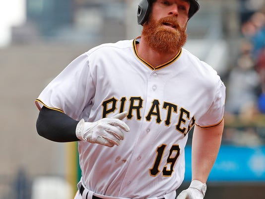 Pittsburgh Pirates' Colin Moran rounds third after hitting a grand slam off Minnesota Twins' Lance Lynn in the first inning of the Pirates' home opener baseball game in Pittsburgh, Monday, April 2, 2018. (AP Photo/Gene J. Puskar)