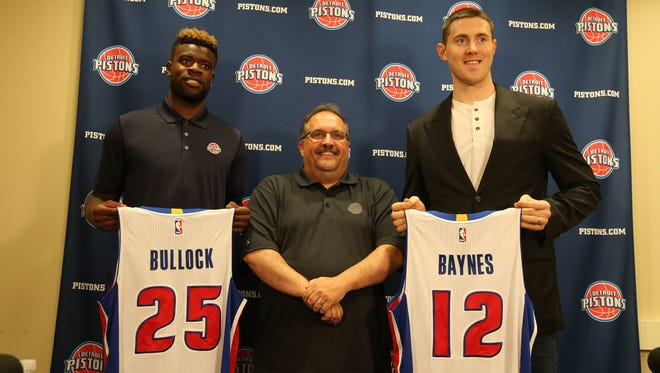 Reggie Bullock, Piston head coach Stan Van Gundy and Aron Baynes after the press conference announcing the singings the two new additions to the team on Sunday, July 12, 2015 in Auburn Hills Michigan.