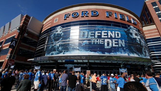 Lions fans gather outside the main entrance of Ford Field in 2014.