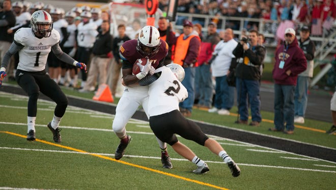Ankeny receiver Chris McLeod (center) is a key returner from last year's close 27-24 loss to Ankeny Centennial.
