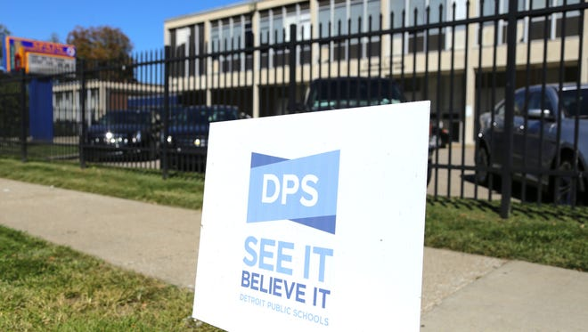 Signage for Detroit Public Schools sits outside of Spain Elementary School in Detroit in Sept. 2014.