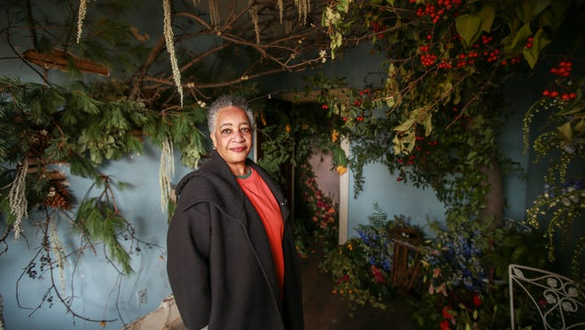 Andromedia Bowden, 71, of Southfield stands in the bedroom on the first floor where her aunt-in-law, Hallie Bills, lived, when she owned the home before 1986. Bowden visited the home that is abandoned and now the site of the flower-art installation, The Flower House in Hamtramck on Saturday, Oct 17, 2015.