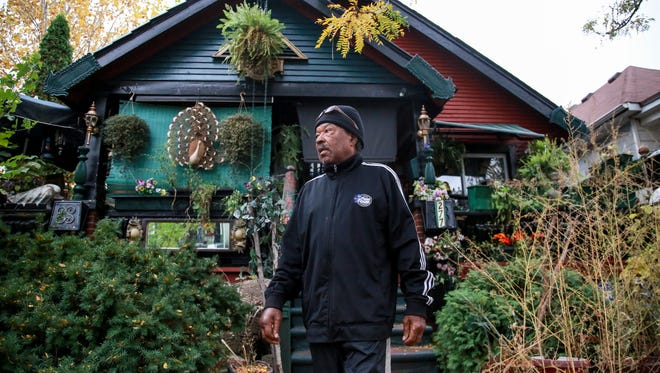 Pete Jackson, 77, of Belleville walks down the steps of his family home in Highland Park.