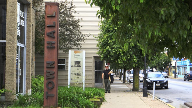 The Elmwood Place Municipal Building became the scene of a heated political fracas recently.