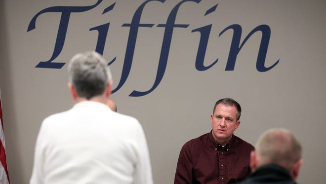 Tiffin Mayor Steven Berner listens to a Tiffin community member during a public hearing regarding the minimum wage at the Tiffin City Council meeting on Tuesday, Nov. 10, 2015.