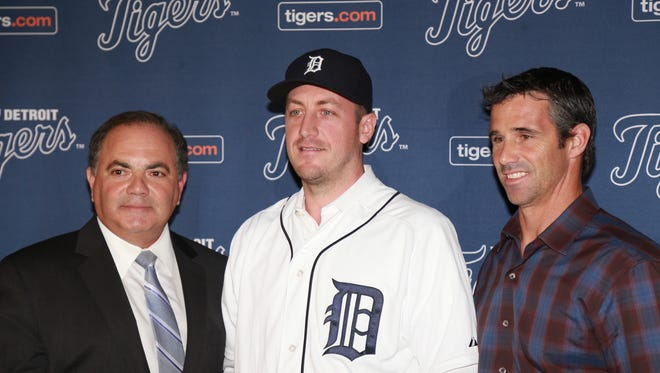 Detroit Tigers GM Al Avila (left) and Detroit Tigers manager Brad Ausmus (right) pose for a photo with Jordan Zimmermann a news conference Nov. 30, 2015 at Comerica Park in Detroit.