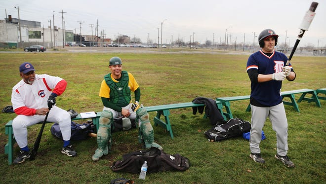 From left, Greg Chastang,Inkster and Greg Wilson, Detroit, and Scott Misuraca of Warren usually participate in baseball with the Men's Senior Baseball League from April-September. They are playing a pick up game at Navin Field in Detroit on Sun., Dec. 13, 2015. They said this is their first time ever playing baseball in December.
