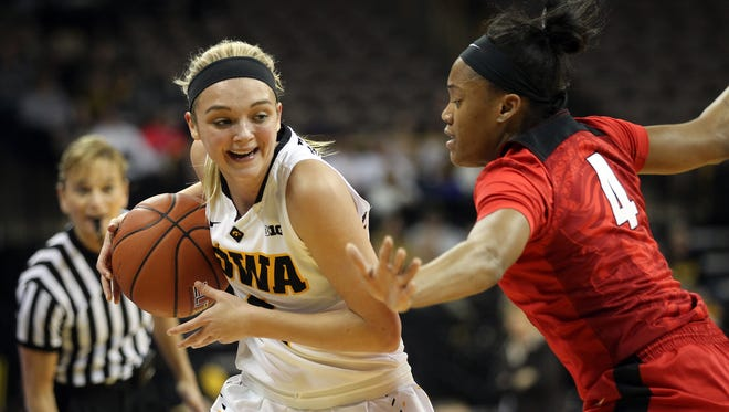 Iowa's Ally Disterhoft fights off Rutgers' Briyona Canty during their game at Carver-Hawkeye Arena on Monday, Jan. 4, 2016.