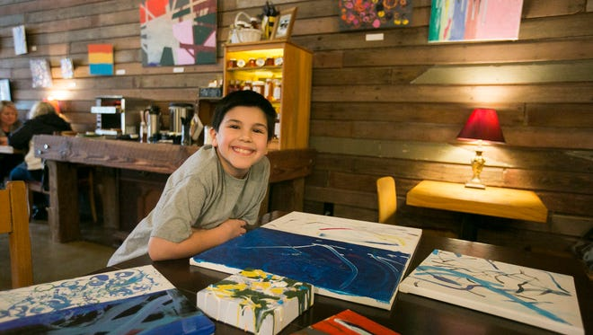 Nine-year-old artist Solen Lewis donated 100 percent of the proceeds from the sale of his artwork at Urban Grange Coffee to the local nonprofit Salem Dream Center.