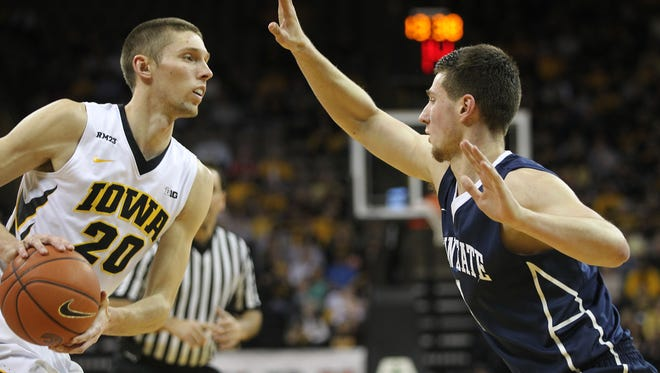 Iowa's Jarrod Uthoff is guarded by Penn State's Deividas Zemgulis during their game at Carver-Hawkeye Arena on Wednesday, Feb. 3, 2016.