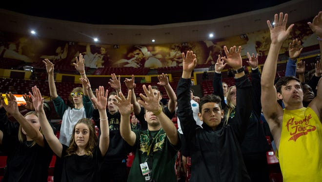 The Basha High School student sections watches a free throw during the Division I boys basketball state tournament quarterfinals against Pinnacle at Wells Fargo Arena on Wednesday.
