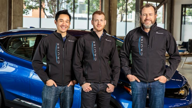 Daniel Kan, left, and Kyle Vogt, cofounders of San Francisco start-up Cruise Automation, are with General Motors President Dan Ammann.