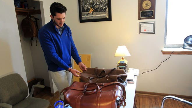 University of Iowa junior Conor Paulsen shows off some of GentlemenCare's leather products in his office at the Bedell Entrepreneurial Leaning Lab on Wednesday, April 13, 2016.
