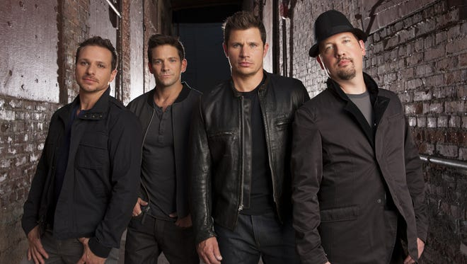 98 Degrees members (from left): Drew Lachey, Jeff Timmons, Nick Lachey and Justin Jeffre.