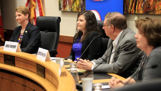 Iowa House District 77 candidates speak to guests during a public forum at the Coralville City Hall on Thursday.