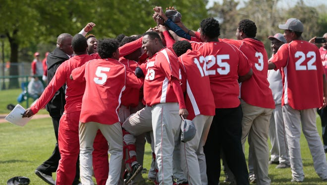 Osborn Knights celebrate their 18-4 win against Henry Ford during the 2016 PSL boys' East-West Division baseball championships at Wayne State University in Detroit on Monday, May 16, 2016.