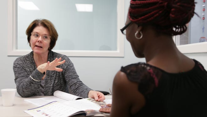 Volunteer tutor Marjorie Paone explains to a Detroit Free Press reporter how she helps Shanda Moses 30 of Detroit with her reading class organized by the Dominican Literacy Center/Reading Works at the Samaritan Center in Detroit on Friday May 20, 2016.
