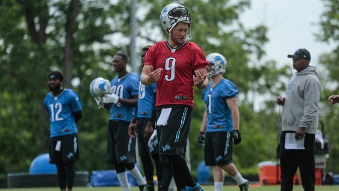 Detroit Lions (QB) #9 Matthew Stafford talks with teammates during team practice at the Detroit Lions Headquarters in Allen Park on Thursday June 9, 2016.