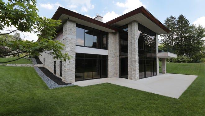 The materials are the same Fond du Lac stone, Indiana limestone, mahogany  and cedar.