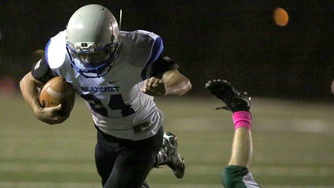 Blanchet's Nicholas Orlandini (24) runs the ball on Friday, Oct. 16, 2015, in Salem, Ore.