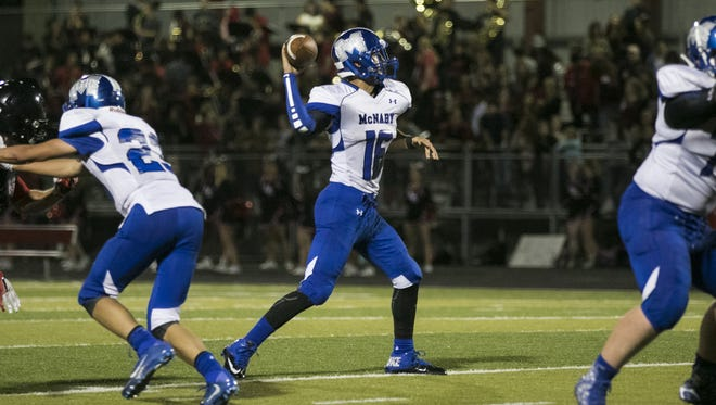 McNary quarterback Josiah Gilbert makes a pass in the second half of the season opening-game against North Salem on Friday, Sept. 2, 2016, at North Salem High School. McNary won the match-up 38-35.