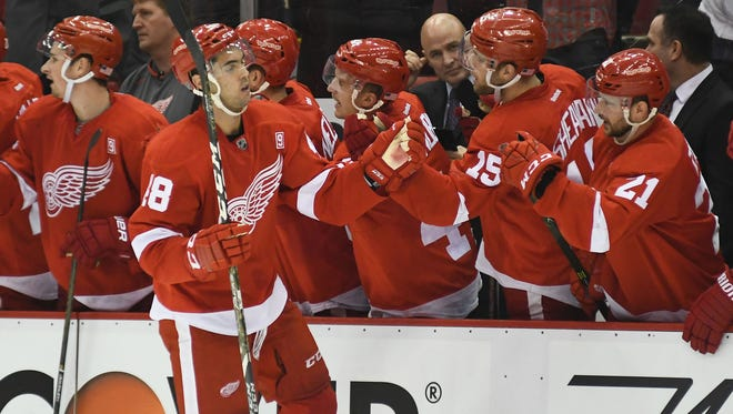Red Wings defenseman Ryan Sproul (48) celebrates his goal with teammates during the third period of the Wings' 4-3 loss Tuesday at Joe Louis Arena.