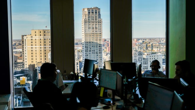 RapidAdvance employees at work with a view of the city on Wednesday, November 9, 2016, in Detroit.