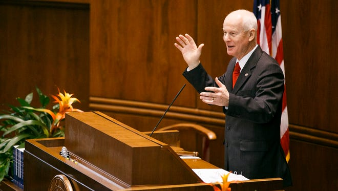 Dennis Richardson tells a story about piloting a combat helicopter in the Vietnam War after he is sworn in as the secretary of state on Friday, Dec. 30, 2016, in the Senate Chamber of the Capitol. The secretary of state's office is starting an audit of Oregon's foster care system.