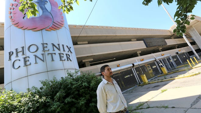 Michael Stephens,39, Facility Manager and Partner at Ottawa Towers, LLC stands in front of the sign to the Phoenix Center in Pontiac on Monday, July 27, 2015. The Phoenix Center, an outdoor entertainment center on 6.7 acres has been closed since 2012.