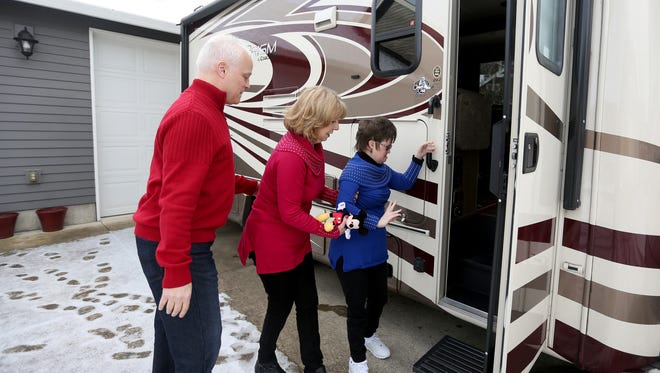 Gary and Renee Kuhn help their daughter, Khrizma Kuhn, 34, into their motor home in their driveway in Woodburn, Ore., on Friday, Jan. 13, 2017. A federal judge recently ruled in favor of the family after their former Keizer homeowner's association prevented them from parking a motor home, used to transfer Khrizma to her medical appointmets, in their driveway.