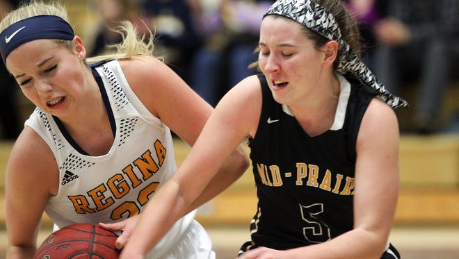 Regina's Kennedy Wallace and Mid-Prairie's Anna Vilovchik fight for the ball during their game at Regina on Tuesday, Jan. 17, 2017.