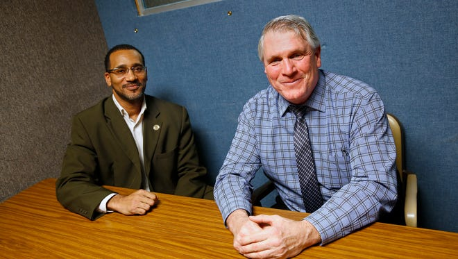 Damon Lane, left, and IMPD Captain Craig Converse sit in a police interview room, Thursday, January 19, 2017.  They met for the first time in 1989 and sat in this room, when Converse questioned Lane in regards to a shooting for which he was arrested.  Lane now works as the Re-Entry Employment Liaison in the Indianapolis Mayor's office of Ex-Offender Re-Entry.  Converse is the Commander in the IMPD Homicide/Robbery Branch.  The two reunited several years ago and now work together sometimes.  This is a success story.