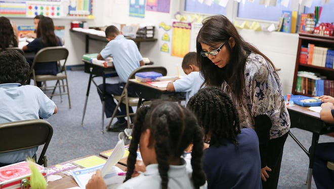 Norma Pizarro teaches math to third, fourth and fifth graders at Capitol City Seventh-day Adventist School in Indianapolis, Monday, Feb. 13, 2017. The school incorporates the Indiana voucher program, which intends to make private school education more accessible to all children.