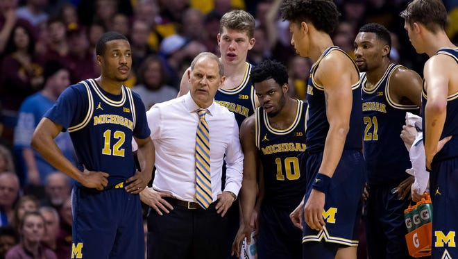 Michigan coach John Beilein watches Minnesota shoot free throws during a technical foul in the second half of U-M's 83-78 overtime loss Sunday in Minneapolis.
