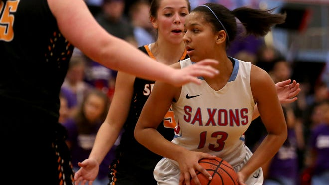 South Salem's Victoria Stafford (13) spins past Sprague players in the first half of the Sprague vs. South Salem girl's basketball game at South Salem High School on Friday, Feb. 3, 2017.