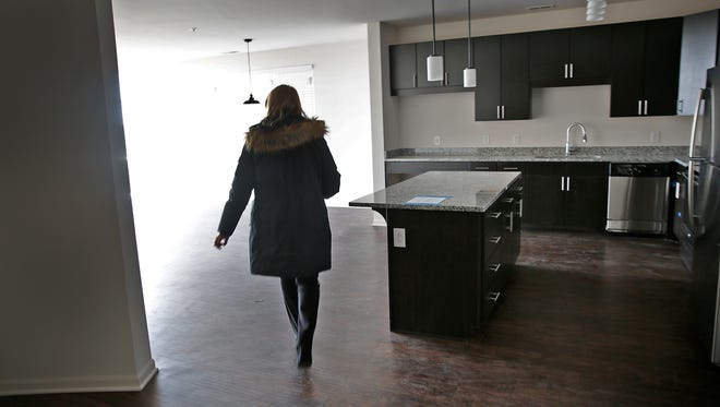 Brittany Lutgring, property manager for The Coil Apartments in Broad Ripple, shows a unit in a March 2017 file photo. A Zillow report says Indianapolis rent prices might go down slightly if Amazon builds a new headquarters in the city.