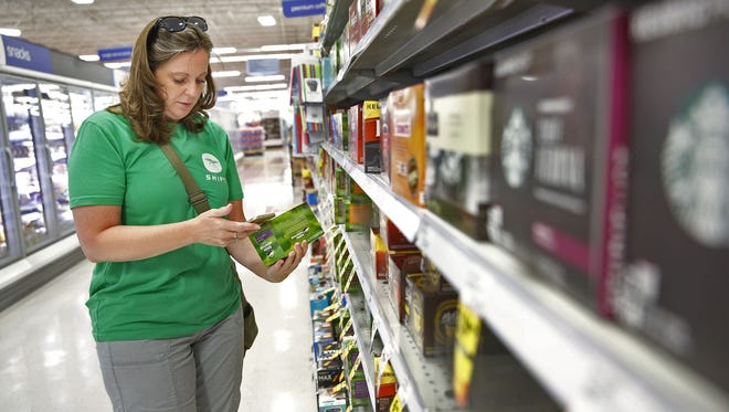 Joelee Smith, with Shipt, shops for groceries for local company, Centerfirst, at the 96th St. Meijer, Thursday, June 29, 2017.  Meijer customers, home or business, place orders through a Shipt app and Shipt shoppers do the shopping and delivery.