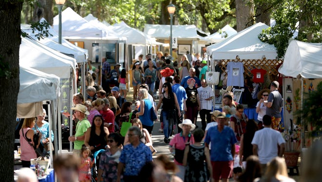 Crowds visit the Salem Art Fair and Festival at Bush's Pasture Park on Friday, July 21, 2017.